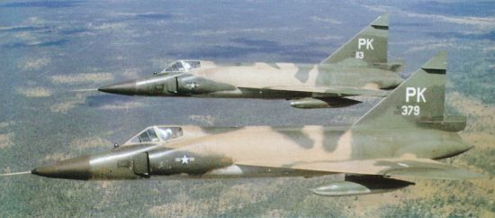 Camouflaged F-102 interceptors on patrol over South Vietnam