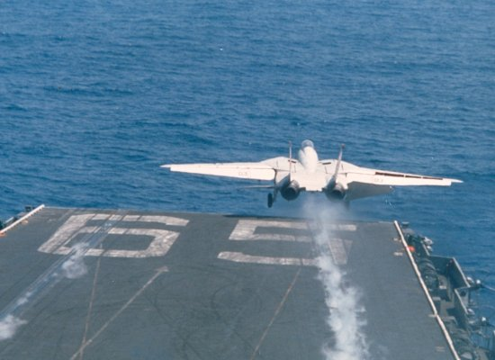 F-14 with wings fully extended during takeoff