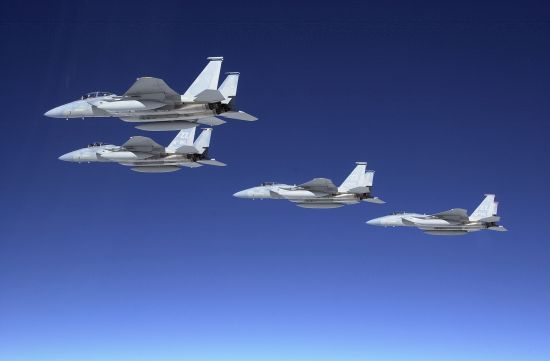 Group of F-15 fighters configured for a long-range ferry mission