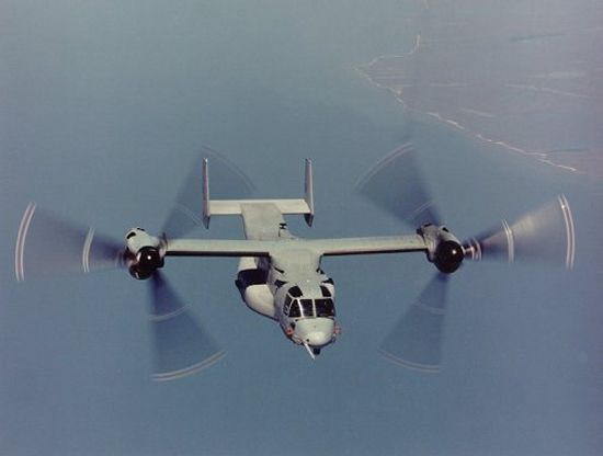 Blade markings visible on a V-22 in flight