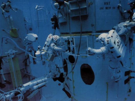 Astronauts training in a water tank
