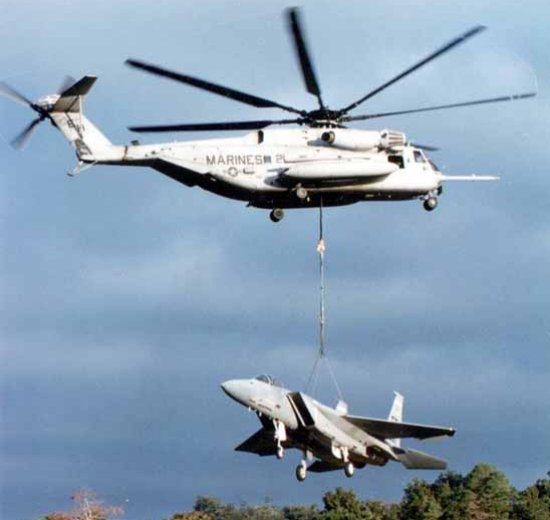 CH-53E Super Stallion lifting an F-15 Eagle fighter